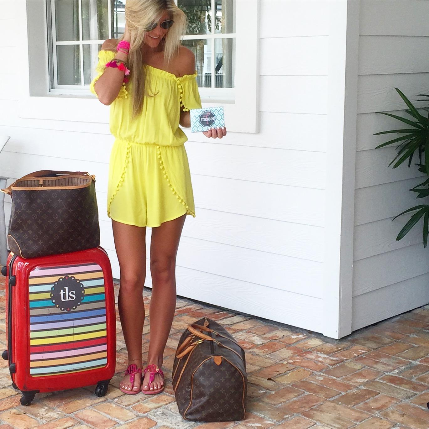 yellow romper, monogrammed suitcase